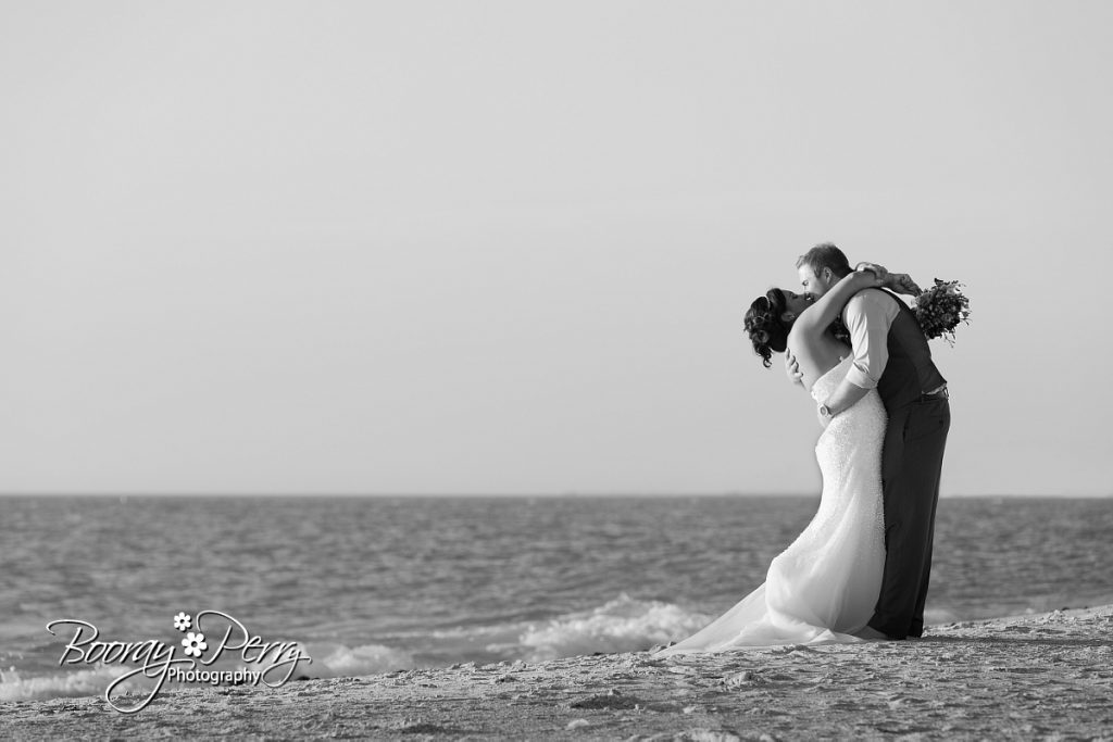 Bride and groom kissing on florida beach
